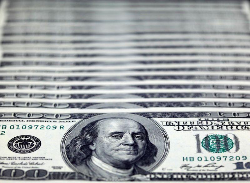 Dollar retreats amid COVID-19, U.S. election uncertainty