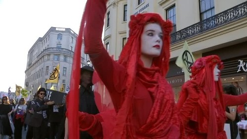 Climate activists stage funeral at London Fashion Week   Reuters Video