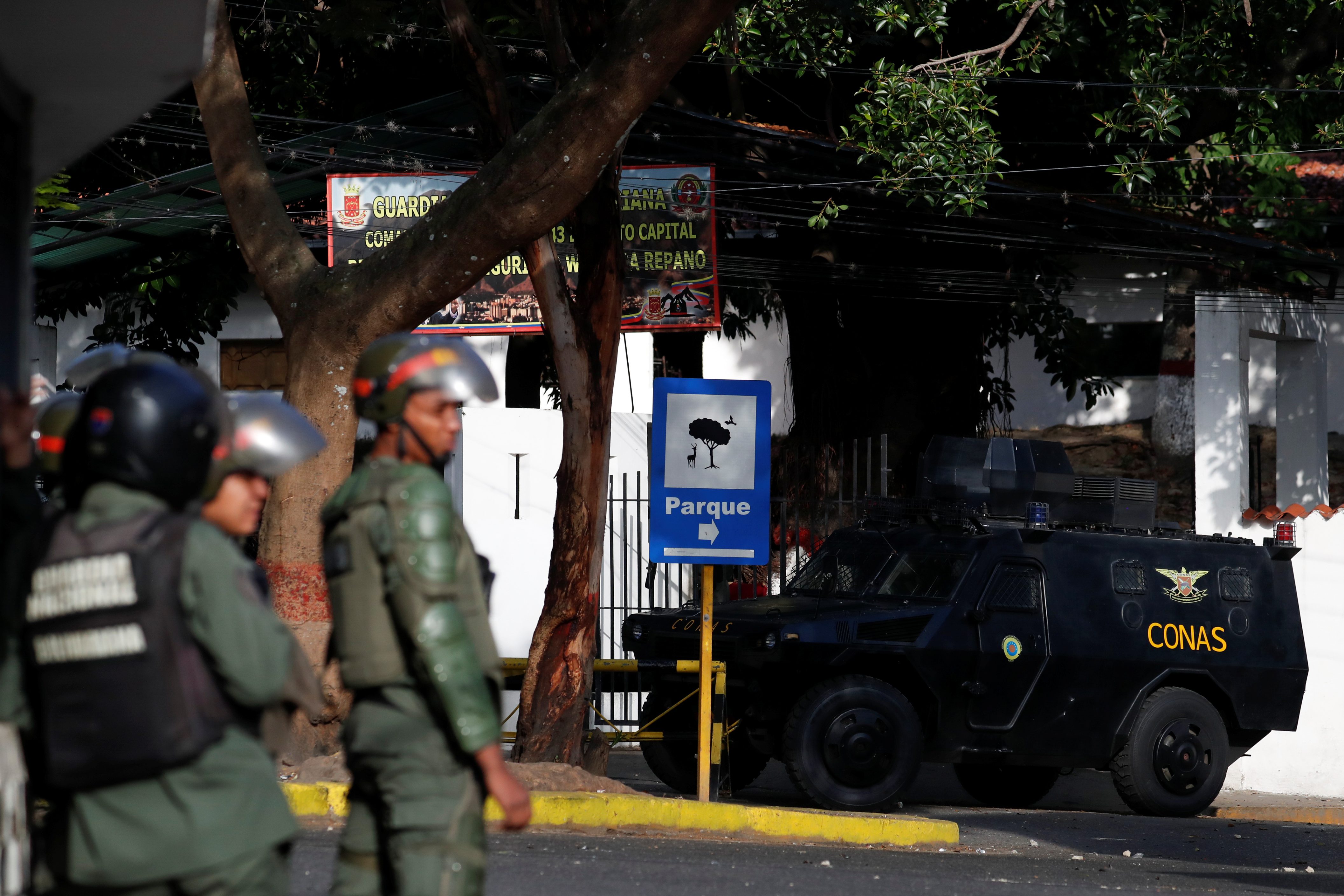 Venezuela says rogue officers captured, military bases under control