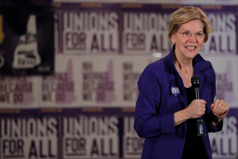 Democrat Warren outlines three-year path to 'Medicare for All'