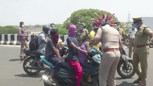 """Stopping traffic: the """"coronahelmet"""" helping Indian police   Reuters Video"""