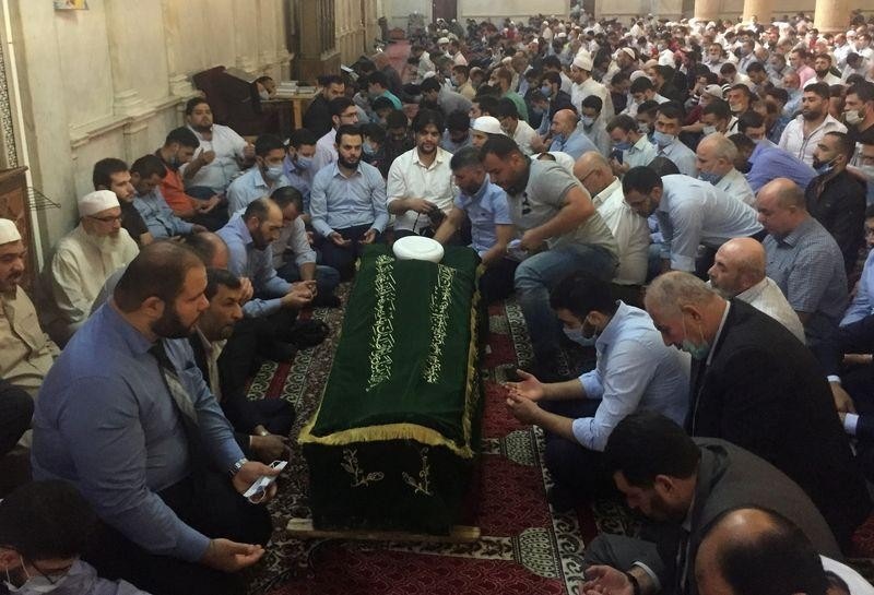 Syrian minister leads mourners for cleric killed in bombing