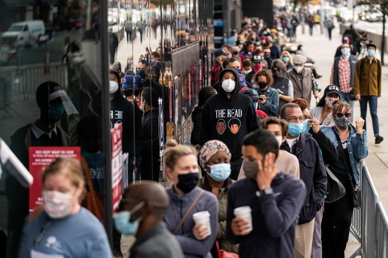Fired-up New Yorkers stand in line for hours to cast early votes