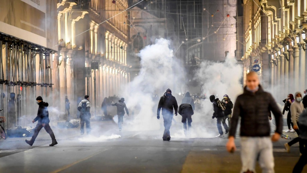 Protests break out in Italy over tougher anti-virus measures