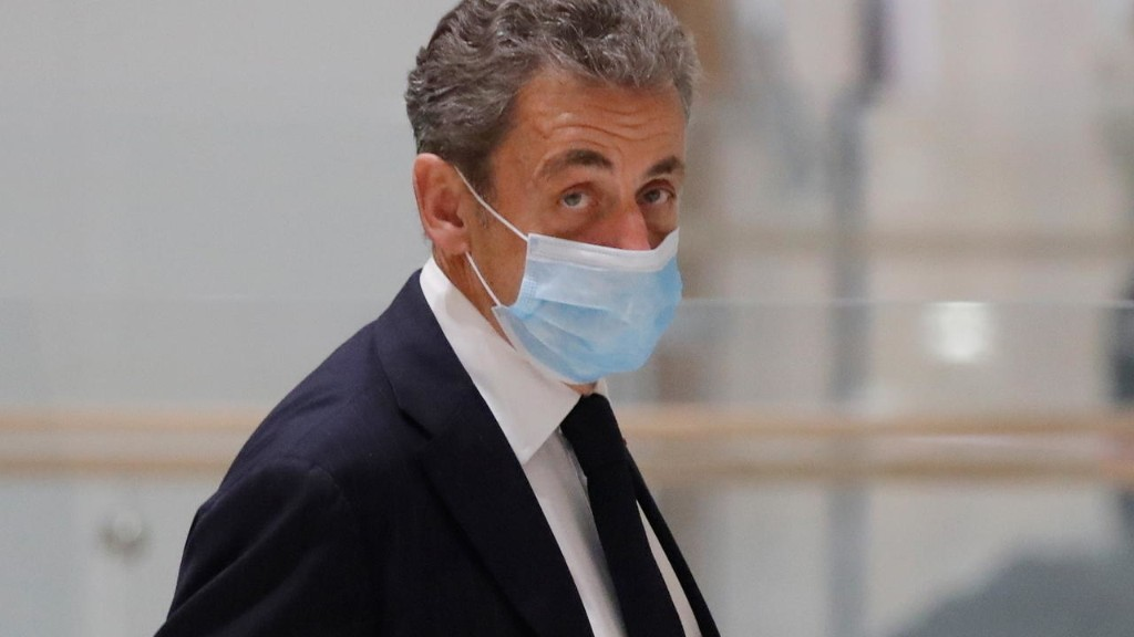 Former president Nicolas Sarkozy leaves court after corruption trial adjourned