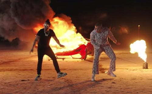Watch Bad Bunny, El Alfa Play With Fire in New 'La Romana' Video