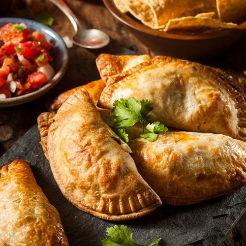 "This cracked ""mystery"" empanada is filled with chicken, mushroom, and cotija"