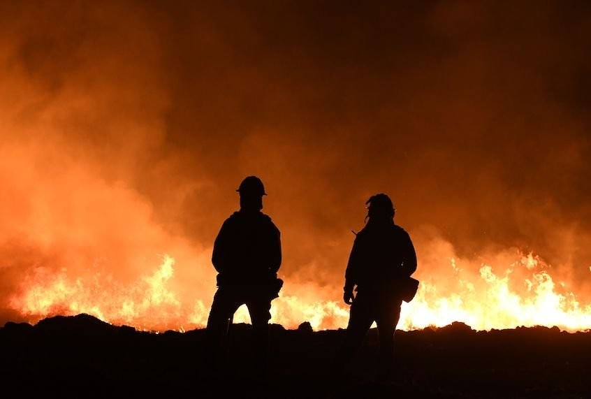 Families push for prisoner release as California wildfires engulf state