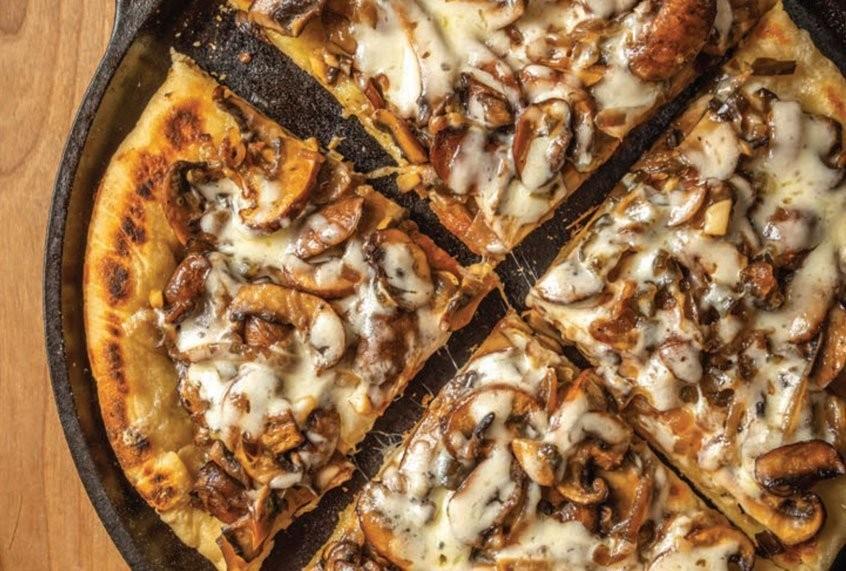 This sautéed onion-mushroom flatbread is elevated by spicy-sweet jalapeños