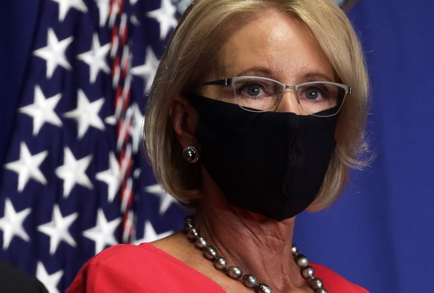 As coronavirus cases surge, Betsy DeVos compares risk of returning to school to riding a rocket ship