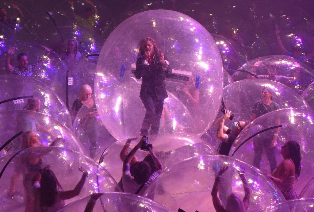 "Flaming Lips' Wayne Coyne: We're the only band ""used to playing in space bubbles"""