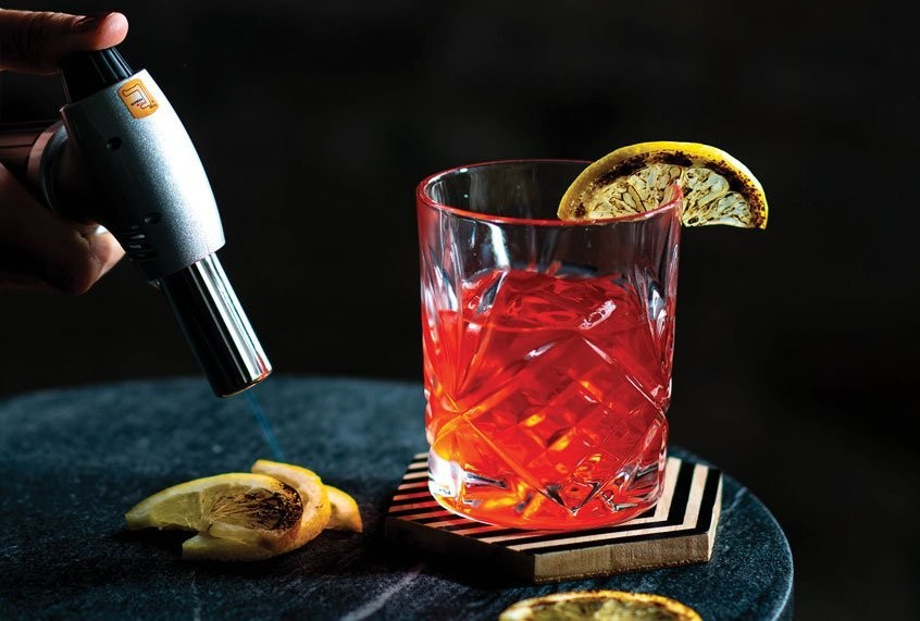 The brighter and sweeter flavor profile of limoncello sends this Negroni soaring to new heights