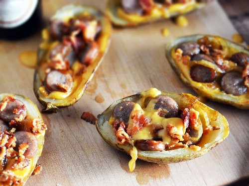 Upgrade Your Potato Skins With Beer-Cooked Onions, Beer-Simmered Brats, Beer Cheese, and Bacon