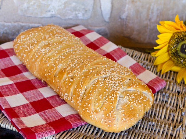 Stromboli with Olives, Sun-Dried Tomatoes, Ham, Salami, and Cheese Recipe