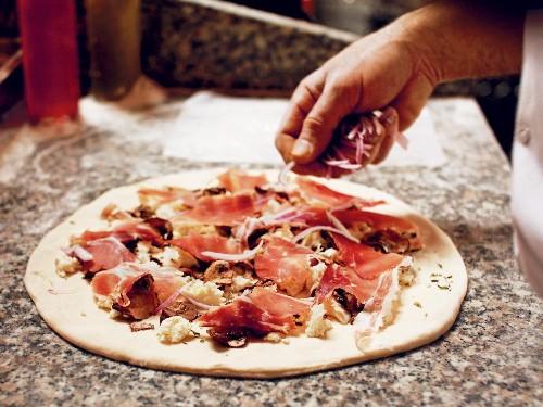 Speckenwolf Pizza With Mozzarella, Oregano, Onion, Mushroom, and Speck From 'Roberta's'