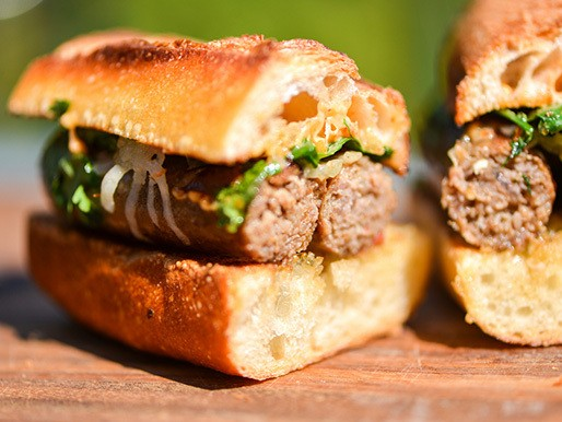 Grilling: Merguez Sandwiches with Caramelized Onions, Manchego, and Harissa Mayonnaise