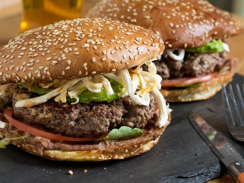 Cemita Burger With Refried Beans, Chipotle Mayo, Avocado, and Oaxacan Cheese Recipe