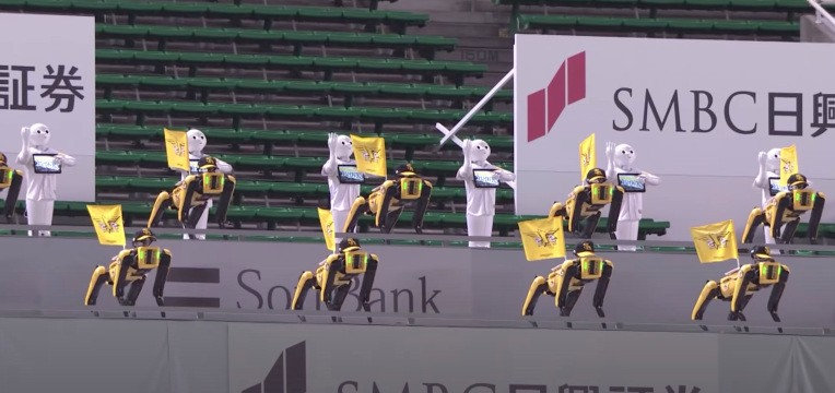 Watch an army of Spot and Pepper robots cheerlead a baseball game in an empty stadium