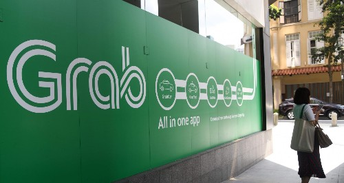 Grab is talking to Ant Financial and PayPal about spinning out its financial services business