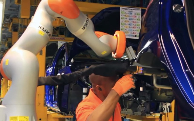 Ford shows how humans and robots work hand-in-hand on its assembly line