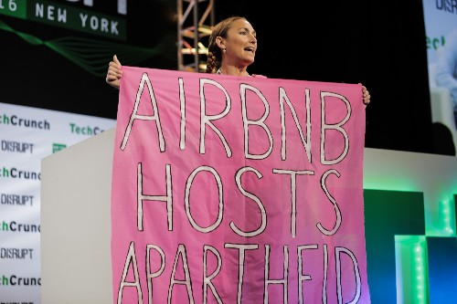 Activists at Disrupt protest Airbnb over listings in Israeli settlements
