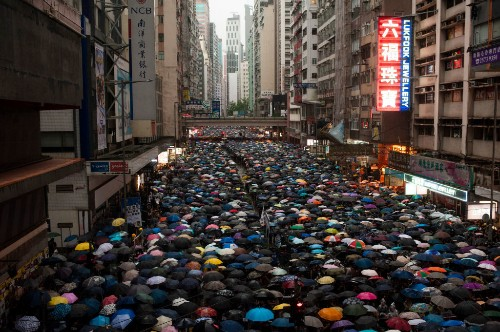 Twitter is blocked in China, but its state news agency is buying promoted tweets to portray Hong Kong protestors as violent