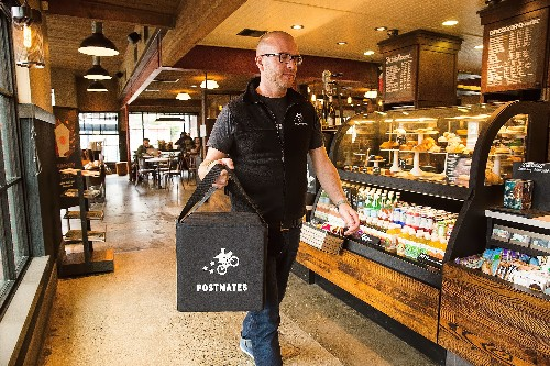 Postmates workers want minimum delivery guarantees and at least $15 per hour