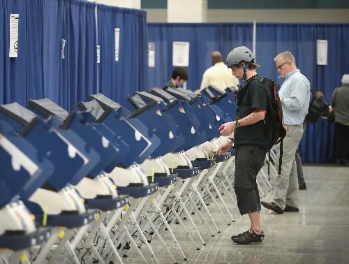Top voting machine maker reverses position on election security, promises paper ballots