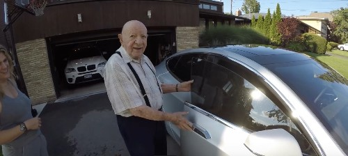 A Tesla owner shows his 97-year-old Grandpa a car from the future