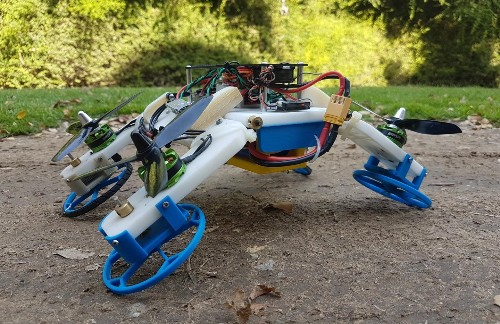 This clever transforming robot flies and rolls on its rotating arms