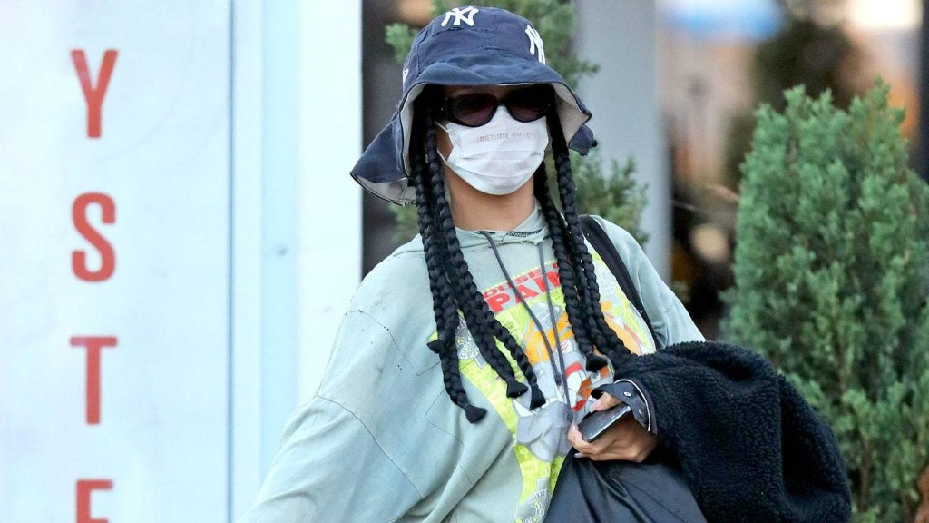 Rihanna Was Peak '90s Cool in a Bucket Hat and Nike High Tops