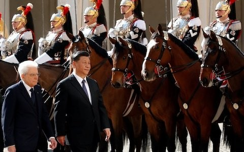 China's President Xi feted in Rome as Italy signs up to Beijing's New Silk Road amid EU and US concerns