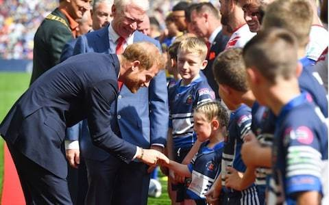 Prince Harry puts private jet storm behind him as he attends Rugby League Final at Wembley Stadium