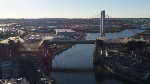 Watch as one of New York's oldest bridges goes out with a bang in thunderous demolition
