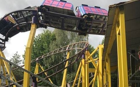 Crying children stuck '50ft in air' for two hours after 'wheel flies off' rollercoaster