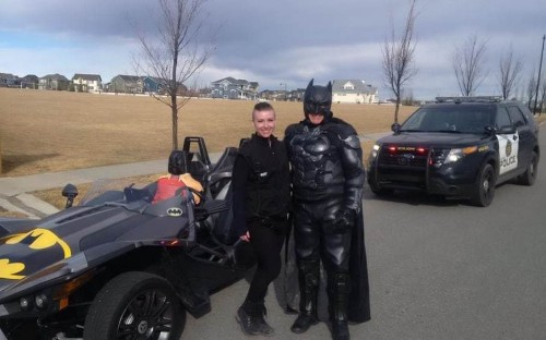 Batman gets pulled over by police and poses for photos