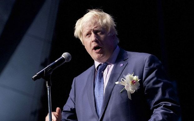 Boris Johnson shows off British cashless technology to Japanese audience... who pay with their mobile phones