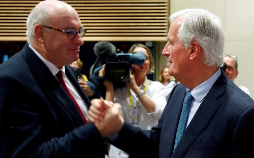 EU accused of 'posturing' by trade minister, as 'slide war' breaks out over claims Brussels has reneged on Canada offer