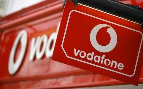 Vodafone cuts dividend after swinging to massive loss