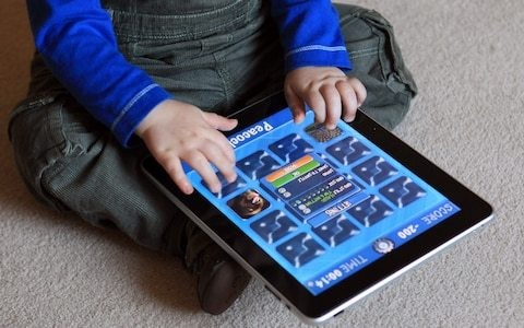 Limit screen time to an hour a day for under 5s with none at all for under 2s, WHO says