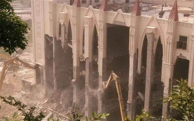 China accused of anti-Christian campaign as church demolition begins