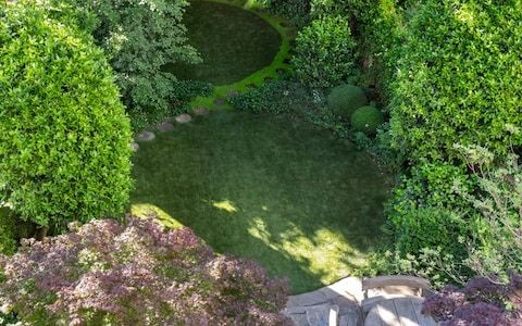 Artificial grass row as conservationists say trend for plastic lawns in gardens is harming wildlife