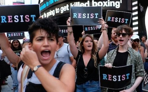 Donald Trump issues order to ban most transgender troops from serving in military