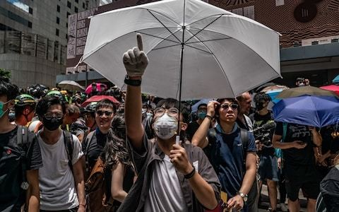 Hong Kong protesters surround police HQ to demand charges dropped against demonstrators
