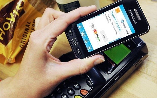 Five reasons why 2014 is the year your mobile becomes your debit card