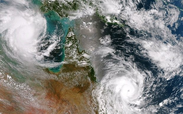 Australia begins clean up after twin cyclones