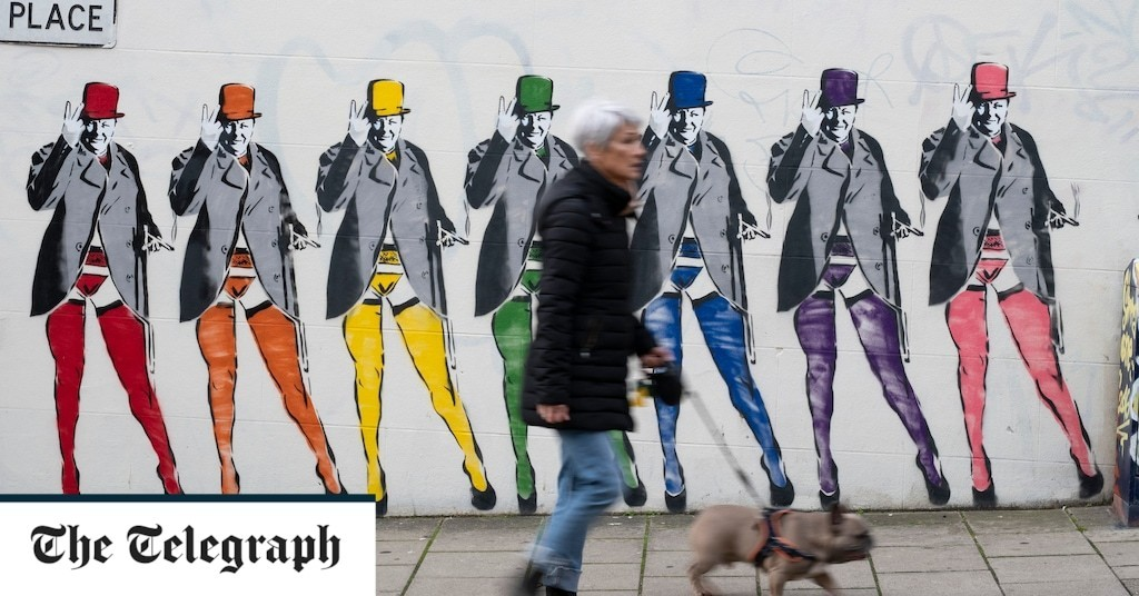 Mural of Winston Churchill wearing stockings and suspenders attracts complaints – for his trademark 'V' sign