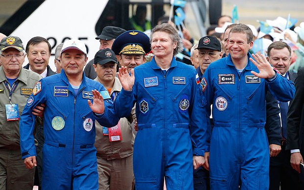 Soyuz capsule returns astronauts to Earth with a bump