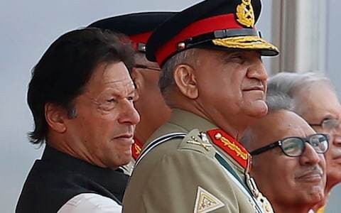 Pakistan's powerful army chief gets three more years at top amid Kashmir tension and Afghan peace drive
