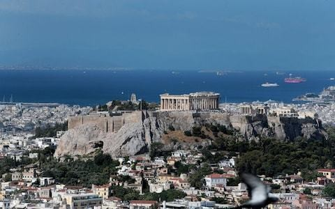 Athens residents flee buildings as strong earthquake hits Greek capital
